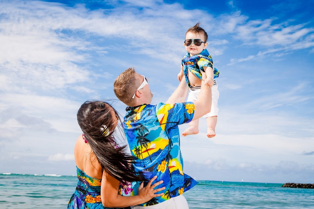 family outdoor photo session beach Four Seasons oahu