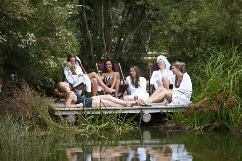 Peninsula-Hot-Springs---Girls-group-relaxing-by-lake.jpg