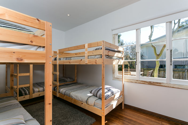 Bedroom 4 (downstairs) with 3 sets of bunk beds and split system