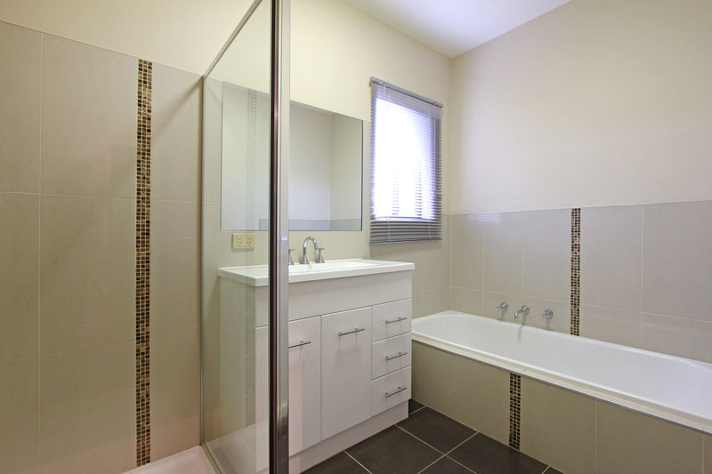 Main bathroom with bath and shower