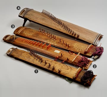 From the  Korean Cultural Heritage Foundation  comes an image showing a variety of Gayageum of different styles, made in 1985 and 2010. #2 is a different kind of instrument.