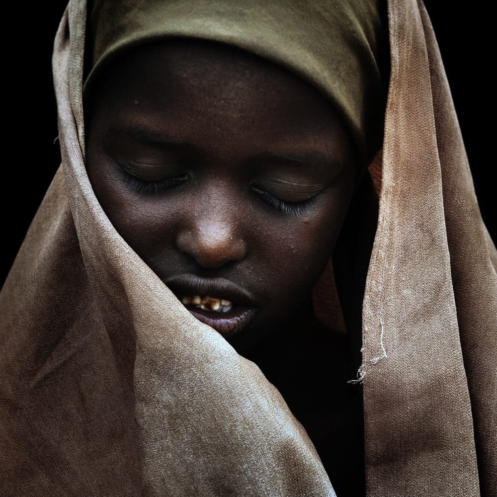 A Somali woman at a refugee camp in Dadaab. From the neighbouring country of Somalia an estimated 8000 refugees cross the border each month to escape the desperate living conditions.