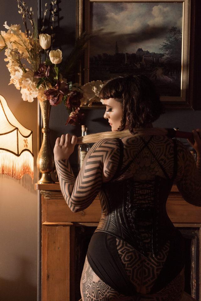 Miss Tallula leather corset flogger.jpg