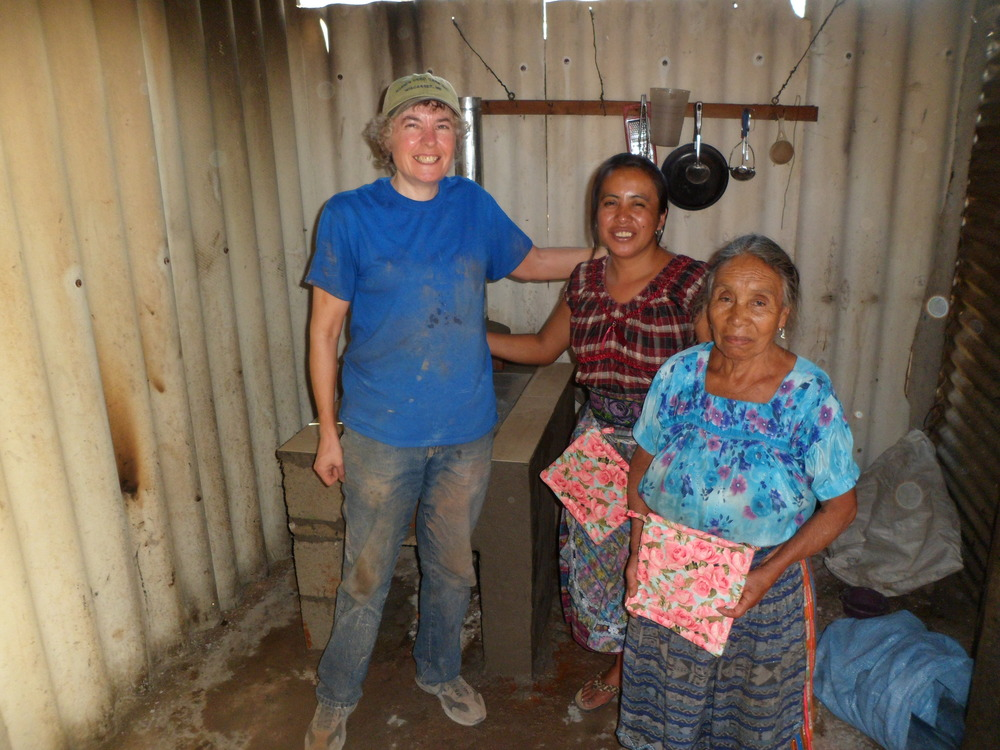 Masons on a Mission Volunteer and UUR member Lorrie Kniesner with a family receiving a Masons on a Mission built stove.