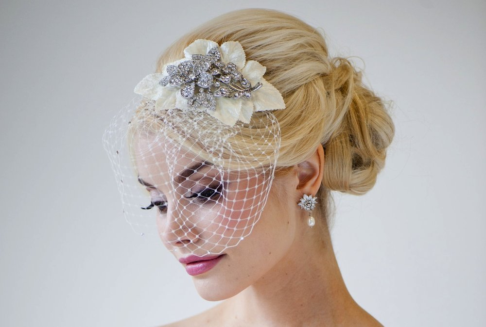 This beautiful birdcage veil adds a romantic feel to her ensemble.