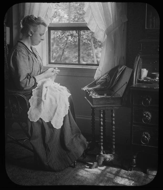 3. 1970.10.T130C  Woman Sewing by Window c.1900