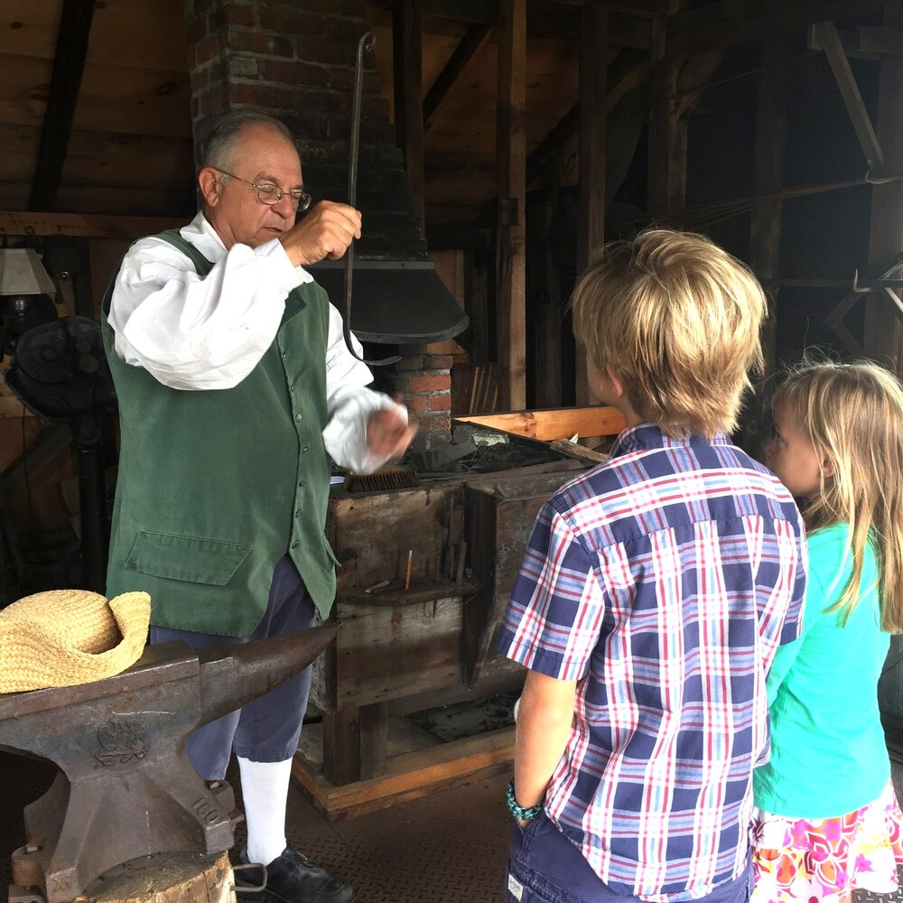 Mike Reveruzzi Entertains His Visitors at the Hopkins Blacksmith Shop