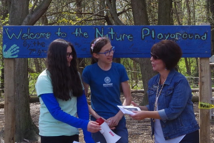students in Amanda Renslow's 7th grade science class exercised problem solving, leadership, and democratic decision making skills in the construction of a Nature Play Area