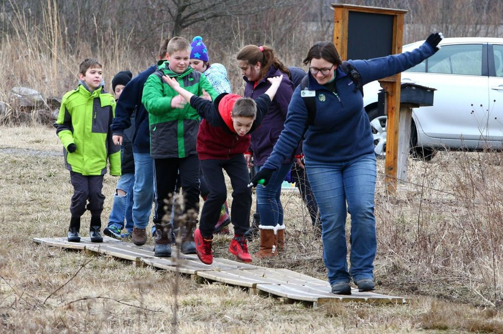 Ellie Althoff, Dunes LEarning Center outreach educator, in early march leads fifth graders from joan martin elementary school in hobart through the gordon & Faith greiner nature preserve    Kale wilk, the times