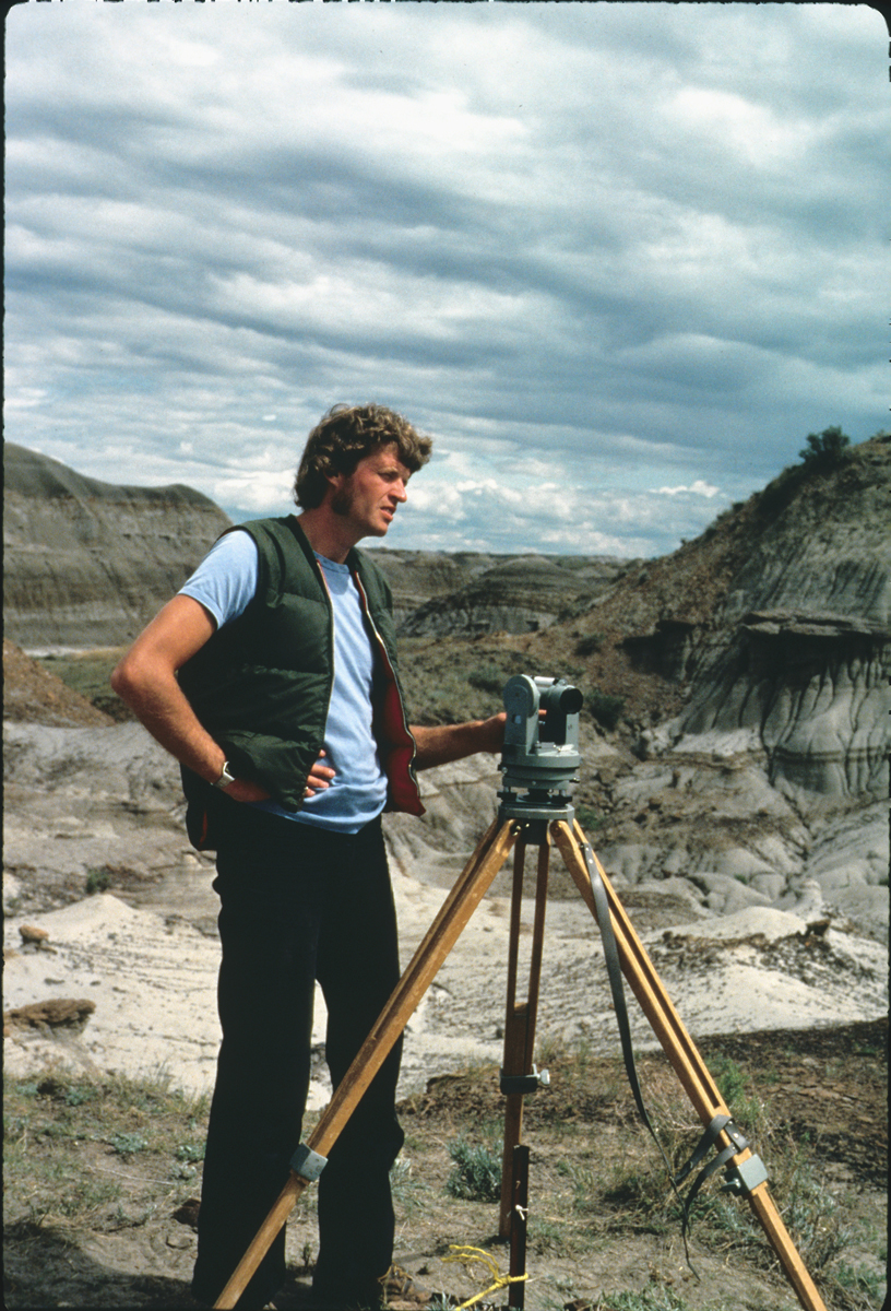 Phil Currie in the early 80's using surveying equipment to map bonebeds.