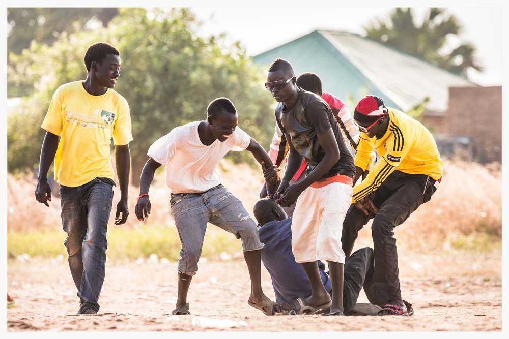 Young men messing around in WBEG State, South Sudan  . Photo © Marcus Perkins