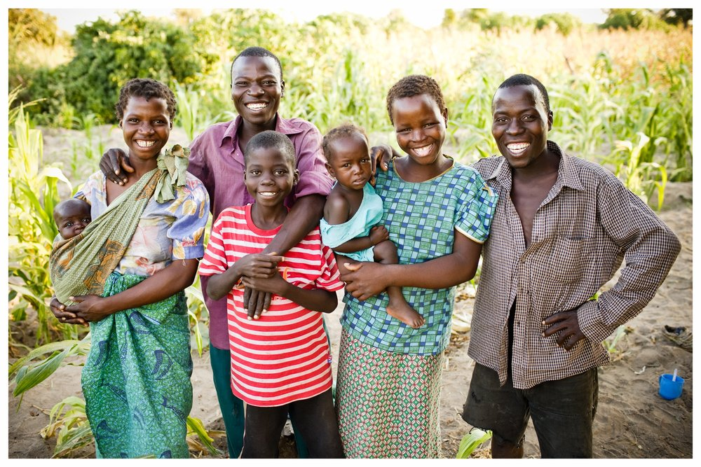 Andrew and family. Fombe, Chikwawa, Malawi. Photo © Marcus Perkins