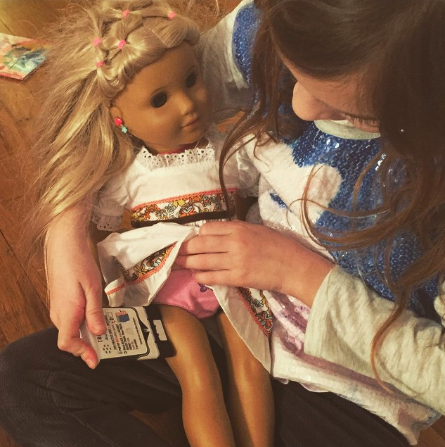 Practicing giving epinephrine injection to her American girl doll, Photo Credit: Kiss Freely