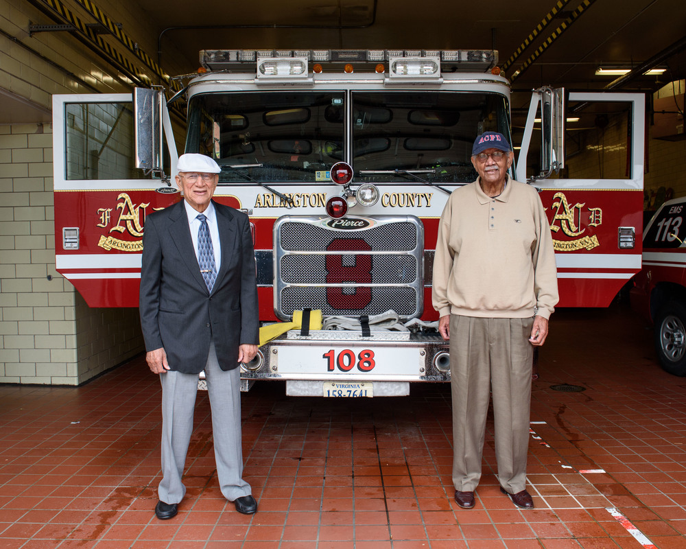 Captain Hartman Reed, left, and Firefighter Julian Syphax, right, pose for a portrait at Fire Station 8.