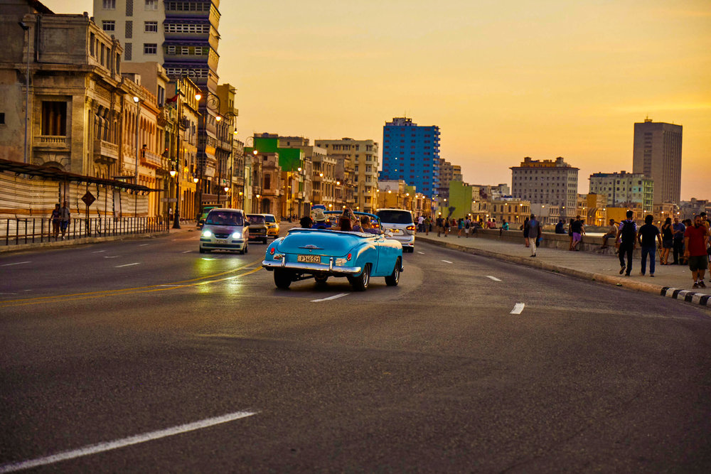 CUBA-CANDELA-classic-car-ride-down-el-malecon