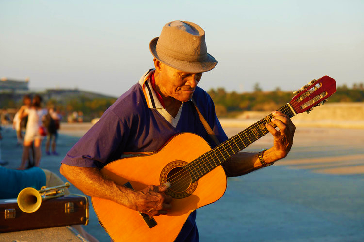 cuba-candela-malecon-guitar-player.jpg
