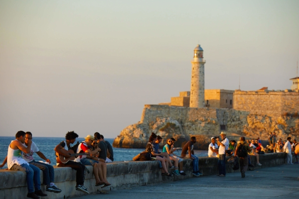 Locals and travelers enjoying the sunset on El Malecón