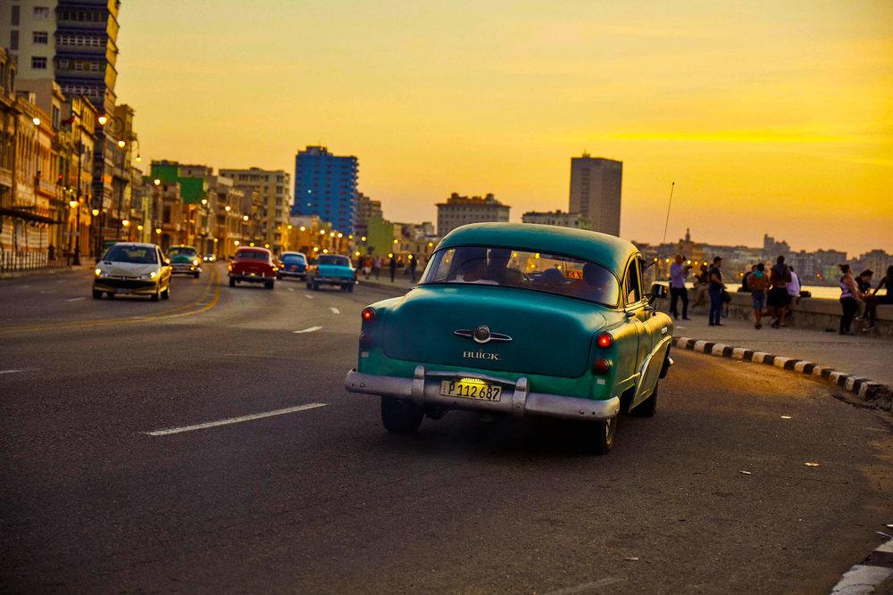 classic_car_journey_malecon_sunset_views_havana_cuba.jpg
