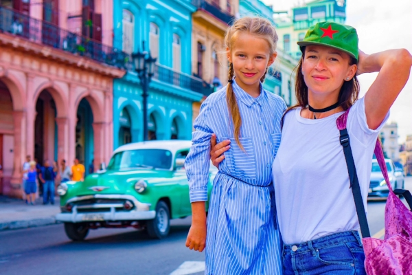 mother_daughter_family_travel_through_cuba_colorful_havana_street