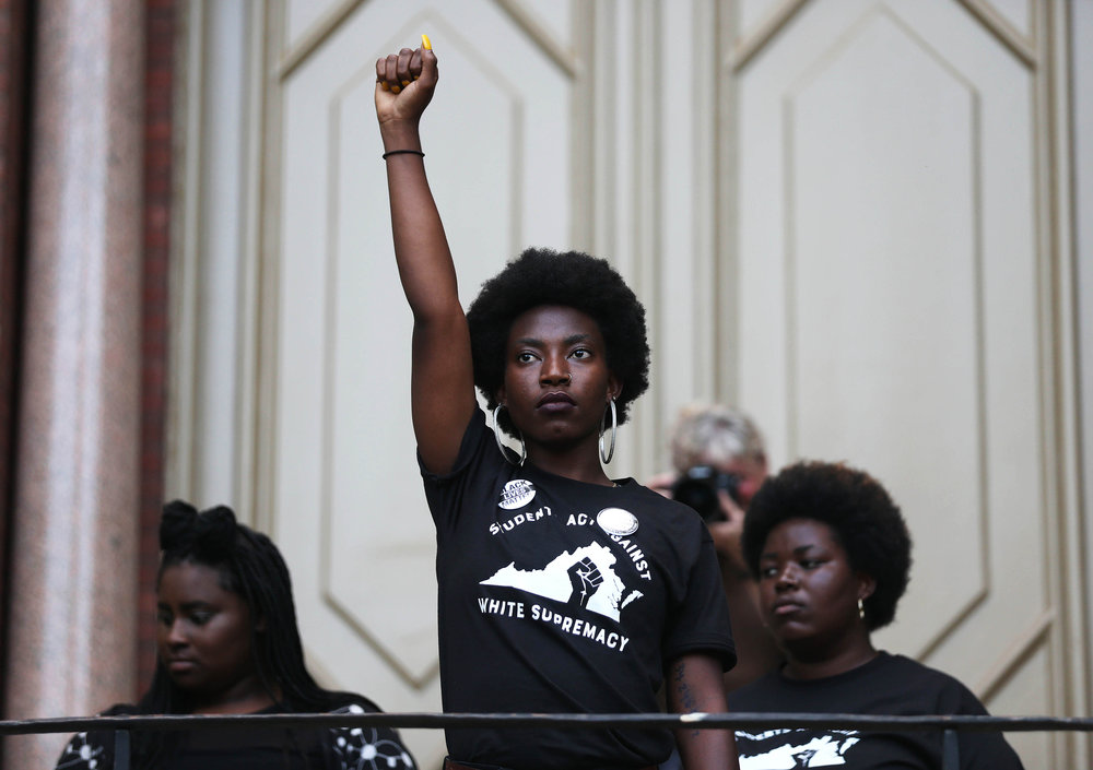 A student protester addresses the crowd after students moved their demonstration to Brooks Hall at the University of Virginia, Aug. 11, 2018. The event was originally organized at the steps of the Rotunda where students stood against a torch lit march by white nationalists at the university a year earlier. The location was moved after students voiced their discontent with security measures taken by the school.