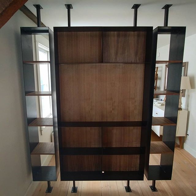 Walnut and blackened steel shelf we designed and built to match the ladder in Munjoy Hill space.  I really like the balance of substance and lightness in this piece. . . . . . . . . . . . #asagormanbuilder #custombuilding #portlandmaine #woodworking #instacarpenter #customhome #custom #mainemodern #fabrication #newconstruction #construction #building #mainehome #wood #carpentry #customwork #walnut #handbuilt #interiordesign #interiors #craft #design #mainehome #finishcarpentry #fineinteriors #shelf #architecture #craft #hardwood #builtnotbought #skilledtrade