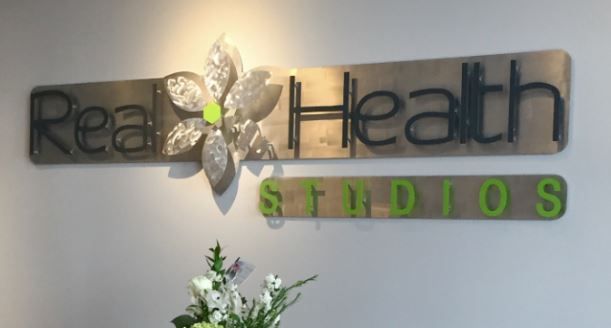 Real Health Studios - Custom Metal Sign.JPG