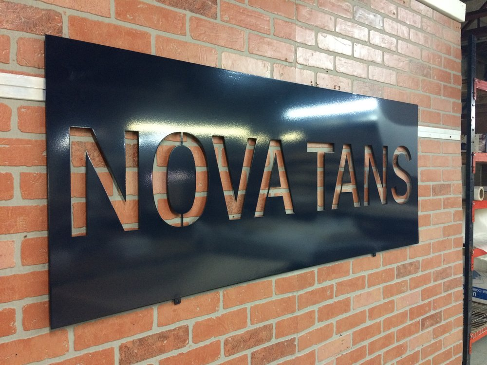 Custom Metal Sign-Nova Tans Exterior-left.JPG