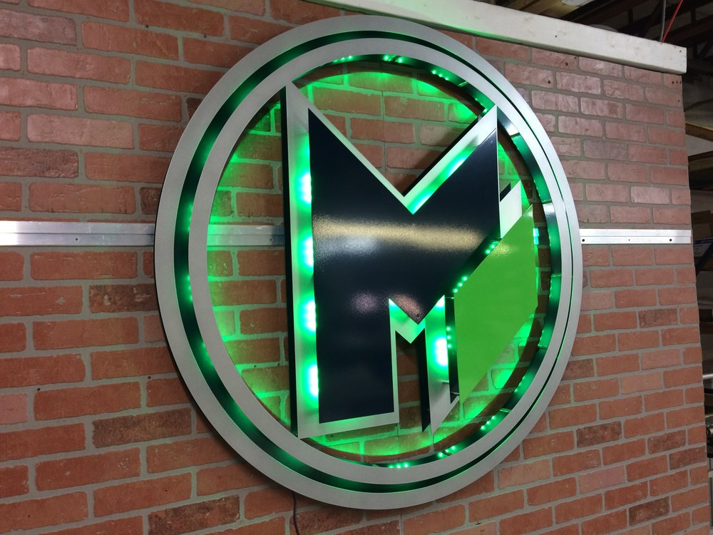 Custom Metal Sign-MoZeus Worldwide-left-lit green.JPG