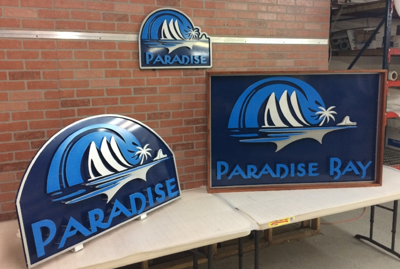 Multiple Set of Signs for Paradise Resort Bay
