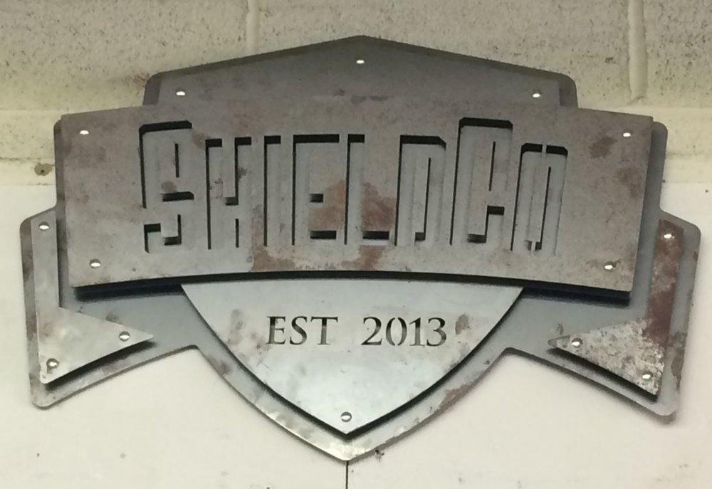 4 - Steel - Custom Metal Sign- ShieldCo Logo (snip).JPG