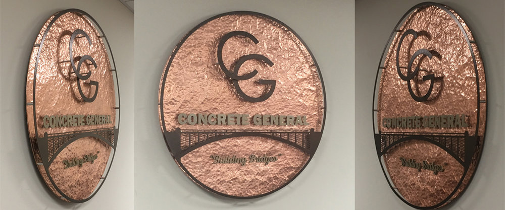 Hand hammered copper backer, laser cut powder coated parts layered onto the sign for 3D effect.