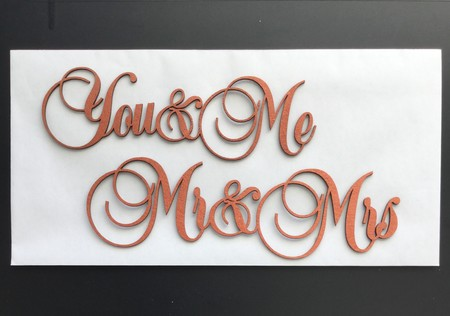 laser cut cursive lettering out of copper.jpeg