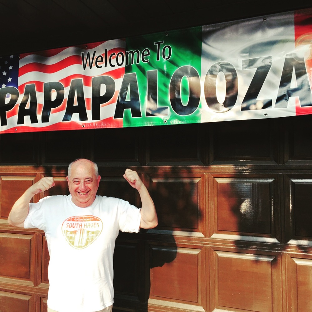Every year my grandparents host a 4th of July party at their house that we call Papapalooza. This is Papa with his banner.