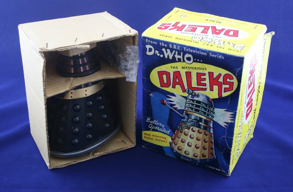 Louis Marx and Company Ltd., The Mysterious Daleks, a battery-operated toy with amazing robot action (black Dalek with grey base in first version of box).