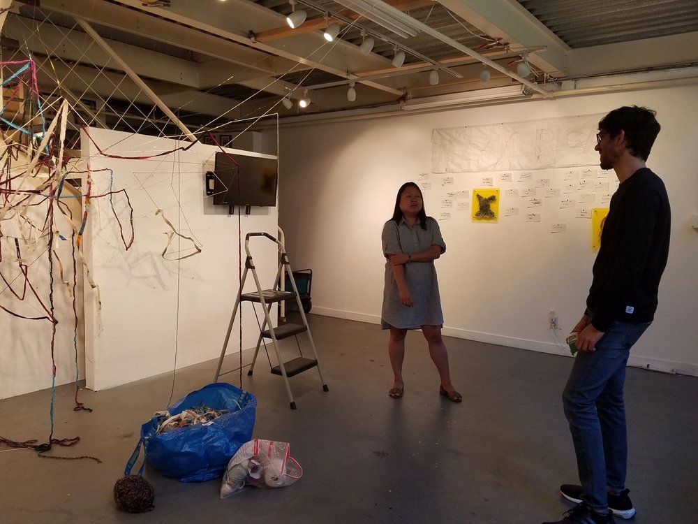 One of the many conversations from artists and friends who visit. Photo by Kristine Schomaker. In photo, left: Diane Williams Right: Pranay Reddy