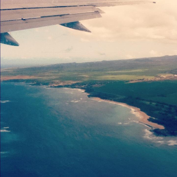 Maui from da plane. Hawaii is insane. Ocean, beaches, sugar cane. And even a little bit of rain.