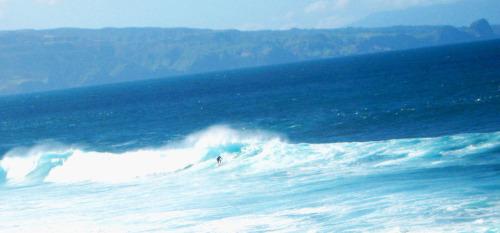 Surfer at Ho'okipa Beach Park off the Road to Hana in Maui.