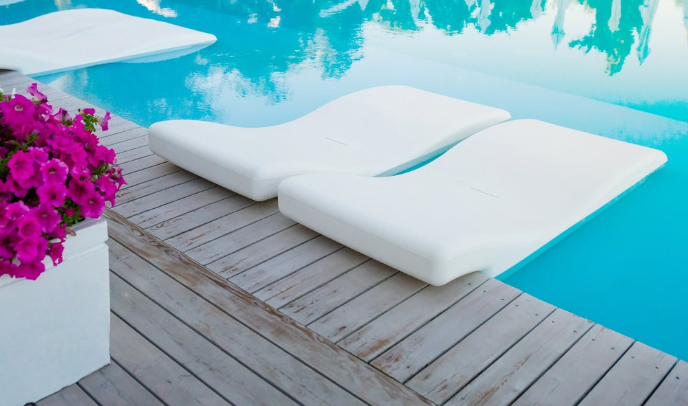 bigstock-Swimming-Pool-With-Chaise-long-231405832.jpg