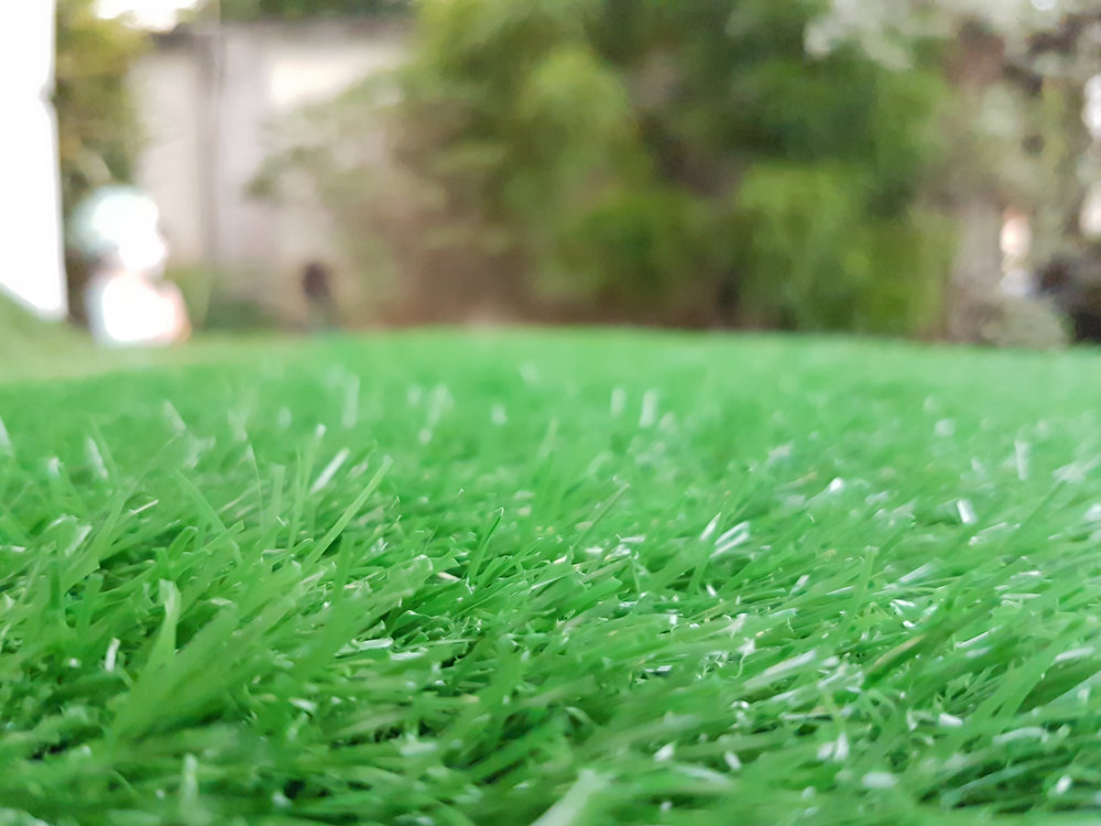 bigstock-The-Green-Artificial-Grass-Dec-214577113.jpg