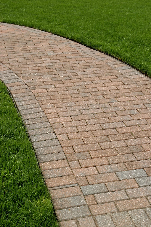 bigstock-A-Perfectly-Edged-Brick-Walkwa-3057042.jpg
