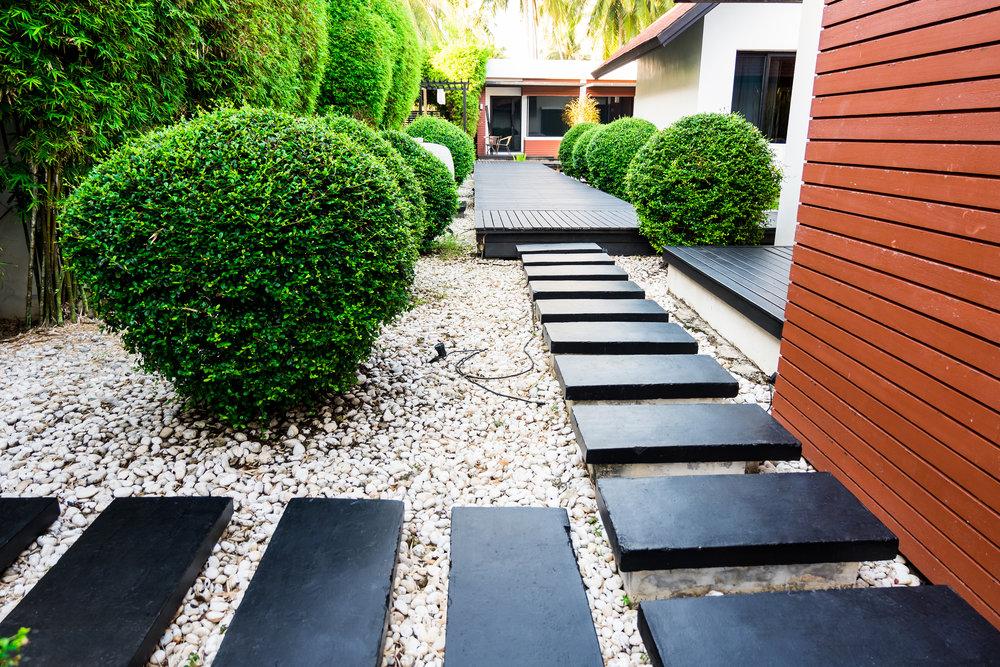 bigstock-Garden-Path-On-White-Pebbles-A-200418136.jpg