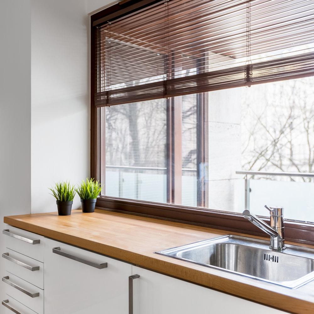 bigstock-Kitchen-With-Wooden-Countertop-196749127.jpg