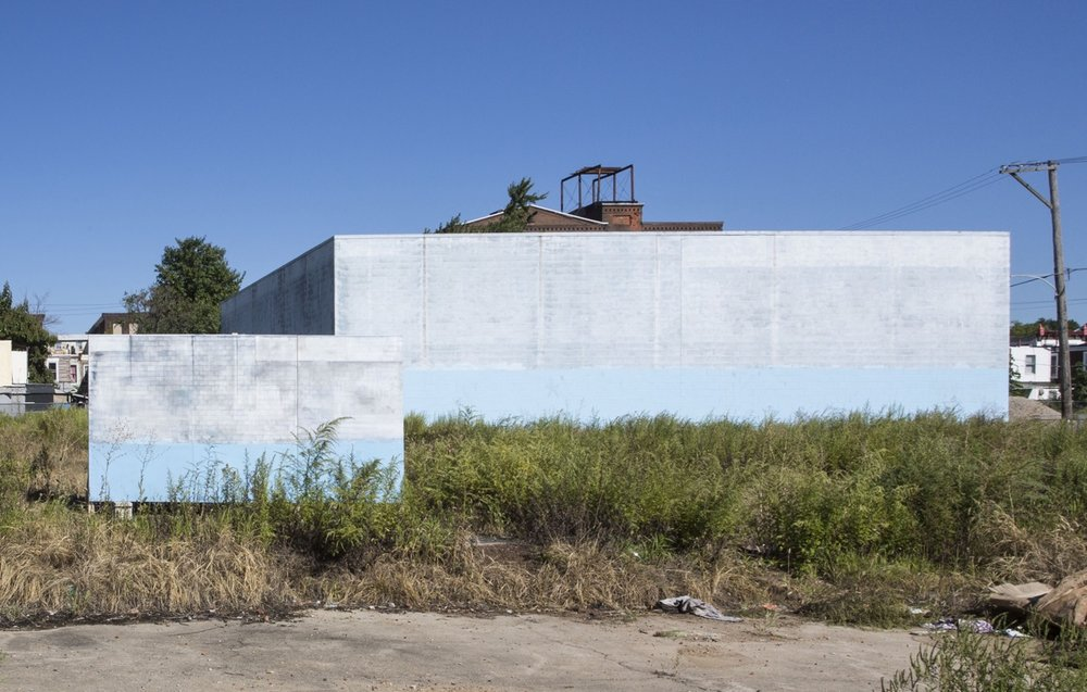 AS IS PROJECT (still), 2016.  Acrylic on wood panel installed in a vacant lot. Courtesy of the artist.