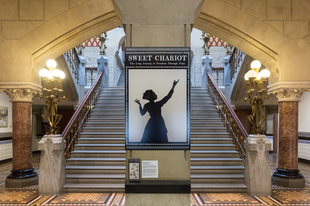Sweet Chariot: The Long Journey to Freedom Through Time   Marisa Williamson  Born in 1985 • American • Based in New York City Video, digital application, and scratch-off ticket Washington Square/PAFA   Photo courtesy of the artist.