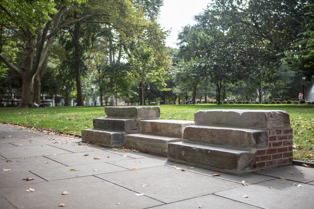 On the Threshold (Salvaged Stoops, Philadelphia)   Kaitlin Pomerantz  Born in 1986 • American • Based in Philadelphia Brick, concrete, marble, blue stone, and brown stone from various demolished buildings throughout the city of Philadelphia. Supplemented with mortar, cinder block, and rebar. Washington Square   Photo: Steve Weinik