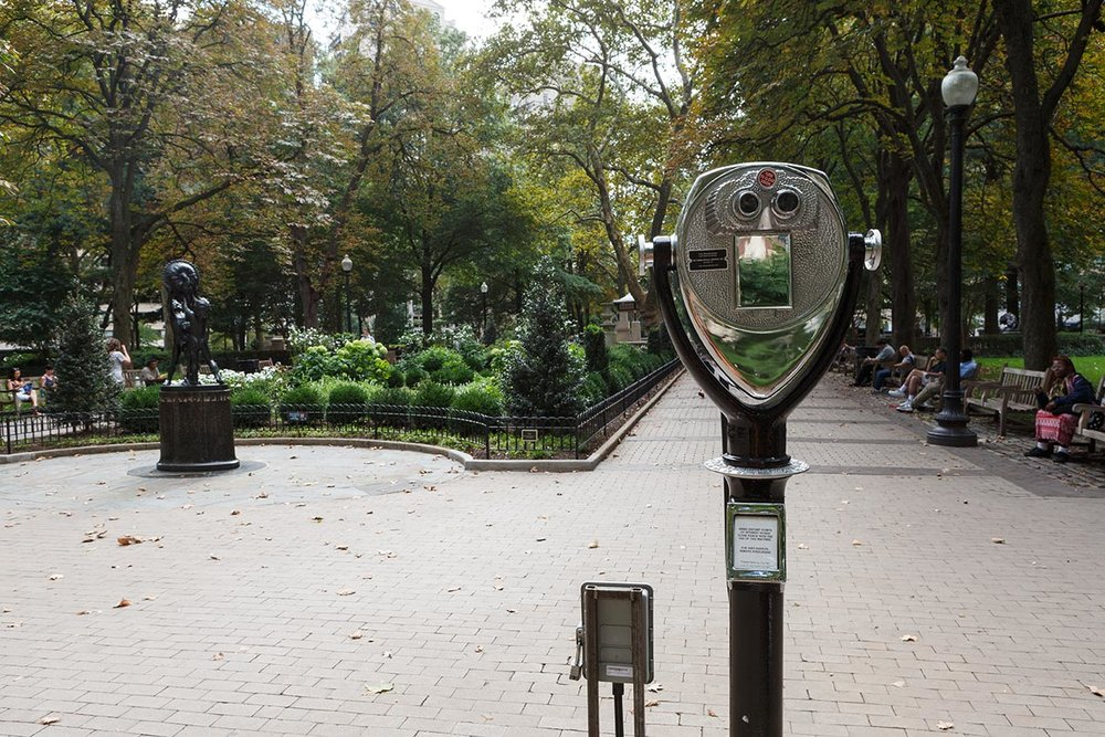The Built/Unbuilt Square  Alexander Rosenberg Born in 1981 • American • Based in Philadelphia Modified coin-operated binoculars, steel, cement, aluminum, iPads, optics, augmented reality software, high-capacity battery packs, black paint, wood, glass, and Rittenhouse Square Rittenhouse Square    Photo: Steve Weinik/Mural Arts Philadelphia