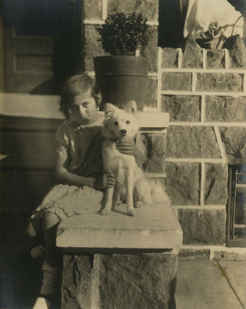 Girl and her dog on a stone porch, Philadelphia. [graphic]. P.2008.10.87. Library Company of Philadelphia.