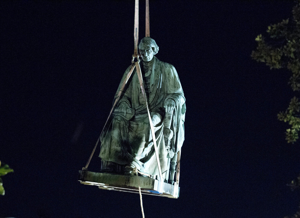 In 2017, workers use a crane to lift the monument dedicated to U.S. Supreme Court Chief Justice Roger Brooke Taney after it was was removed from outside Maryland State House, in Annapolis, Md. ( AP Photo/Jose Luis Magana, File)