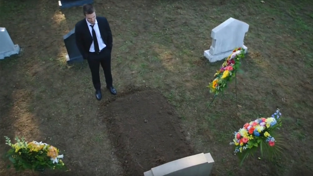Oliver in front of Laurel's grave