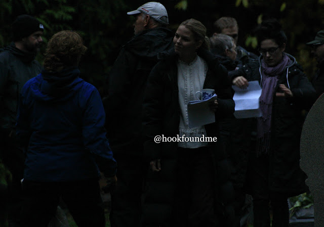 The scene was split into 2 halves. The first was with Regina and the second with the Evil queen. We see Regina, Emma and Hook walking towards the graveyard. We know they are talking to each other but could not hear what about. We then hear Regina shouting at someone which we would then guess would be the evil queen. They run towards to crypt in the graveyard and the evil queen is there. Emma is then in front of them all confronting the evil queen. She is holding a sword. The EQ must say something to Emma to make her mad because she then pushes forward with her sword towards EQ. Hook shouts Emma no. The EQ poofs away because of course she can't be so easily hurt and then the scene ends.  (I wasn't there for the second half of the filming so I do not know if anything else was added to the end of that scene)